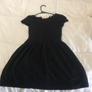 Black dress with open back detail.